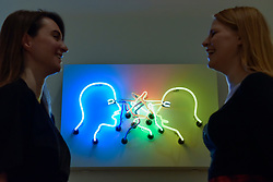 "© Licensed to London News Pictures. 31/07/2017. London, UK. Gallery staff members in front of ""Double Poke in the Eyes II"", 1985, by Bruce Nauman.  Preview of the new Artist Rooms exhibition of Bruce Nauman at Tate Modern on currently until July 2018.  Nauman is widely regarded as one of the most innovative and influential American artists working today.  The Artist Rooms gallery is the London hub for showcasing work from the Artist Rooms collection which is owned jointly by Tate and the National Galleries of Scotland.  Photo credit : Stephen Chung/LNP"