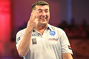 "After celebrating a ""win"", Mensur Suljovic realises he has to win by two clear legs during the First Round of the BetVictor World Matchplay Darts at the Empress Ballroom, Blackpool, United Kingdom on 19 July 2015. Photo by Shane Healey."