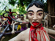 17 JULY 2017 - HUA TAPHON, ANG THONG, THAILAND: Visions of Thai hell in the sculpture garden at Wat Muang in Ang Thong Province. The temple is renowned for its huge Buddha statue which stands 92 m (300 ft) high, and is 63 m (210 ft) wide. Construction started in 1990, and completed in 2008. It is made of concrete and painted gold, and its garden of smaller statues, which represents the Thai version of a hellish afterlife.      PHOTO BY JACK KURTZ
