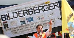 13.06.2015, Telfs, AUT, Demonstration gegen die Bilderbergkonferenz, im Bild ein Demonstrant bei einer Rede // a protester speaking during a demonstration agiainst the bilderberg group in Telfs, Austria on 2015/06/13. EXPA Pictures © 2015, PhotoCredit: EXPA/ Jakob Gruber