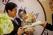 """""""Dol"""" (in Korean language) is celebrated for the first birthday of a child. According to the tradition the parents present the child items as brush, pencil, bow and arrow, money,  needle, ruler and pair of scissors for girls). The item the child picks up are said to predict the child's future. If a child picks up the bow and arrow, it is said that the child will be strong and a warrior. If the child picks up the thread, the child will have a long life. A child who picks up the pencil, book or calligraphy set is forecast to be a good scholar. A child who picks money will become rich in the future."""