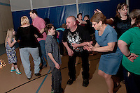 The beat of the music fills the dance floor as Nathan Hardy has some fun with his dad Darrin along with Susan Gunther Director of the Family Support Council, mom Jenn and Laura Michaelis Friday evening at the Gilford Youth Center.   (Karen Bobotas/for the Laconia Daily Sun)