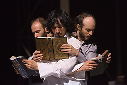 "© Licensed to London News Pictures. 24/01/2014. London, England. L-R: Dimitri Jourde, Yasuyuki Shuto and Sidi Larbi Cherkaoui dancing with the Koran and the Bible. Belgian dancer/choreographer Sidi Larbi Cherkaoui's work ""Apocrifu"" uses the language of the body to explore apocryphal religious texts, accompanied by the polyphonic singing from the all-male Corsican vocal ensemble ""A Filetta"". Dancers: Sidi Larbi Cherkaoui, Dimitri Jourde and Yasuyuki Shuto. Performances at the Queen Elizabeth Hall, Southbank Centre from 24th to 25the January 2014. Photo credit: Bettina Strenske/LNP"