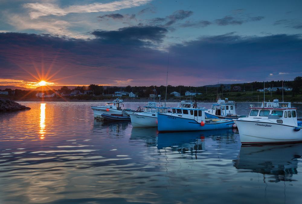 A colorful sunset in Ingonish harbor, Ingonish, Cape Breton, Nova Scotia, Canada