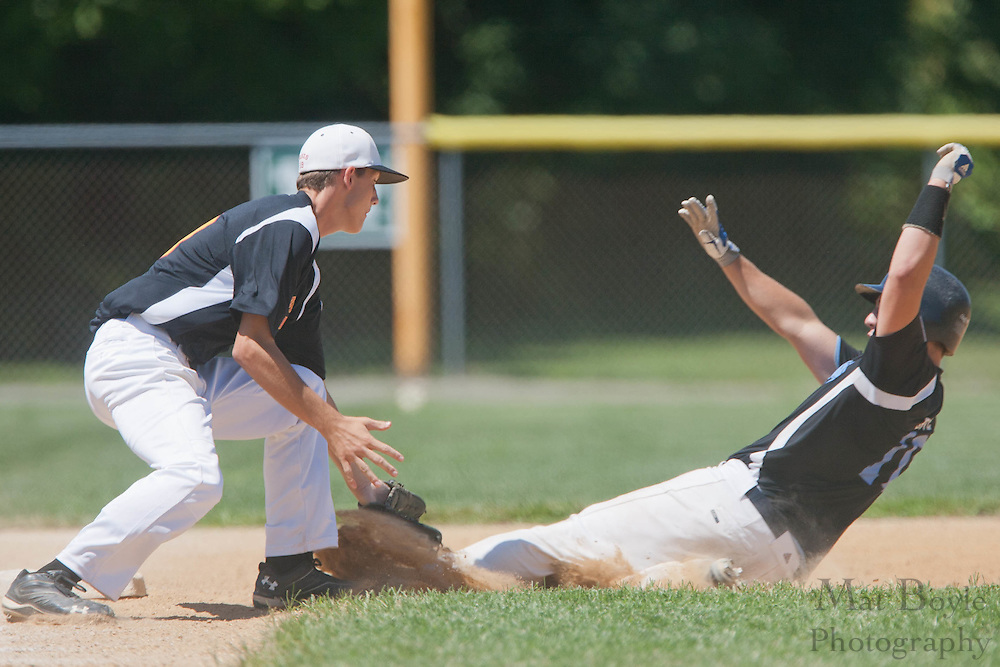 Pennsylvania's Trent Grove gets tagged out at 3rd base by Maryland's Dustin Jones after knocking in two runs in the 2nd inning during the winner take all final of the Eastern Regional Senior League tournament between Pennsylvania and Maryland held in West Deptford on Thursday, August 11.