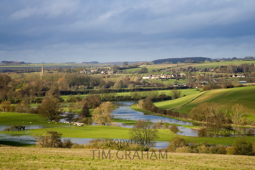 Windrush River and flooded water meadow in valley, Burford, The Cotswolds, United Kingdom