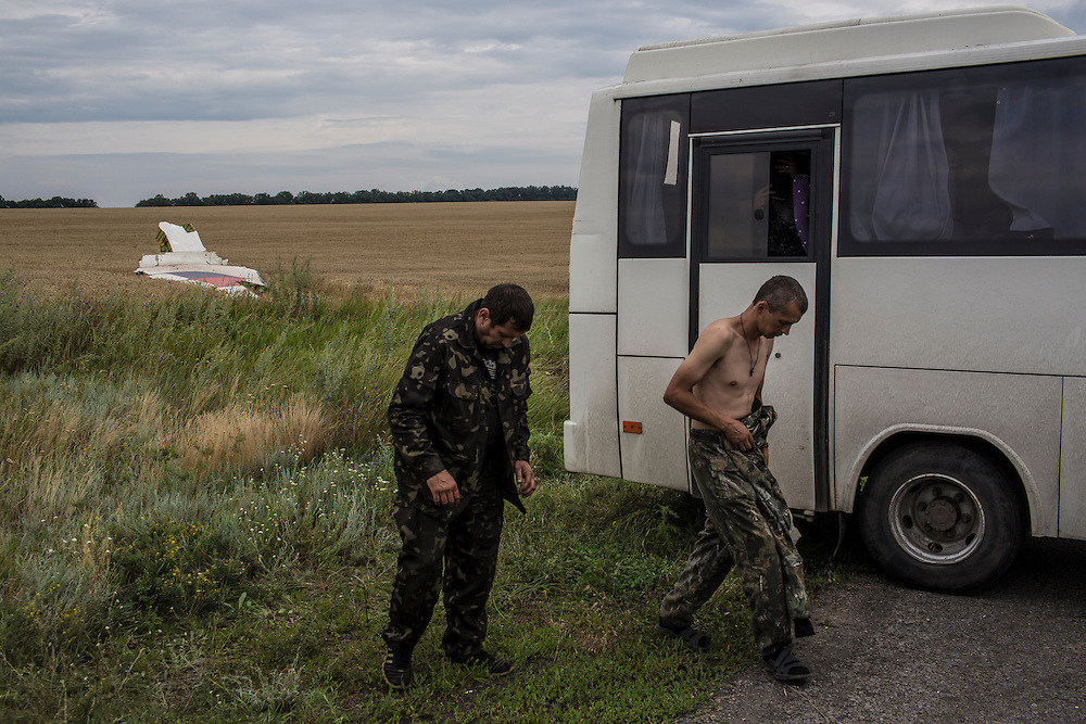 GRABOVO, UKRAINE - JULY 19: Pro-Russia separatist fighters gather near the scene of the crash of Malaysia Airlines flight MH 17 after establishing control of the site on July 19, 2014 in Grabovo, Ukraine. Malaysia Airlines flight MH17 was travelling from Amsterdam to Kuala Lumpur when it crashed killing all 298 on board including 80 children. The aircraft was allegedly shot down by a missile and investigations continue over the perpetrators of the attack. (Photo by Brendan Hoffman/Getty Images) *** Local Caption ***