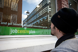© licensed to London News Pictures. London, UK 15/02/2012. An unemployed young man outside a Jobcentre Plus in Victoria, London, as the number of young people without a job rose 22,000 to 1.04m, official figures have shown. Photo credit: Tolga Akmen/LNP