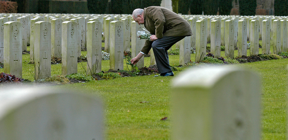 James Hopkins, Halifax Flight Engineer on his return visit to Germany. .James visits the Reichswald Cemetery near Kleve, where his crew members are buried