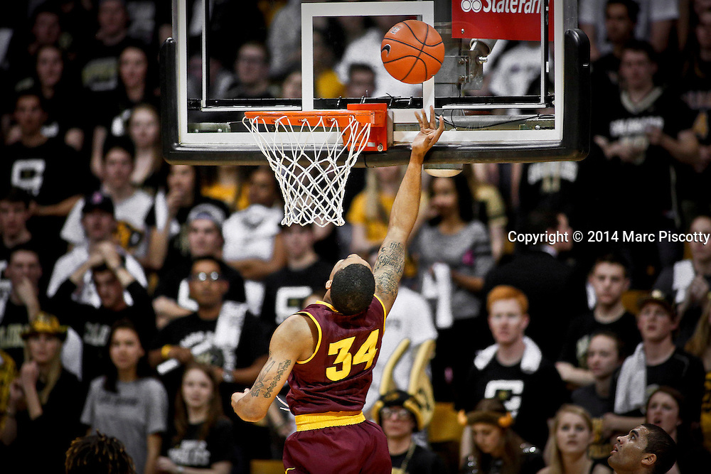 SHOT 2/19/14 11:15:49 PM - Arizona State's Jermaine Marshall #34 tries to tip a rebound in to the basket during their regular season Pac-12 basketball game against Colorado at the Coors Events Center in Boulder, Co. Colorado won the game 61-52.<br /> (Photo by Marc Piscotty / &copy; 2014)