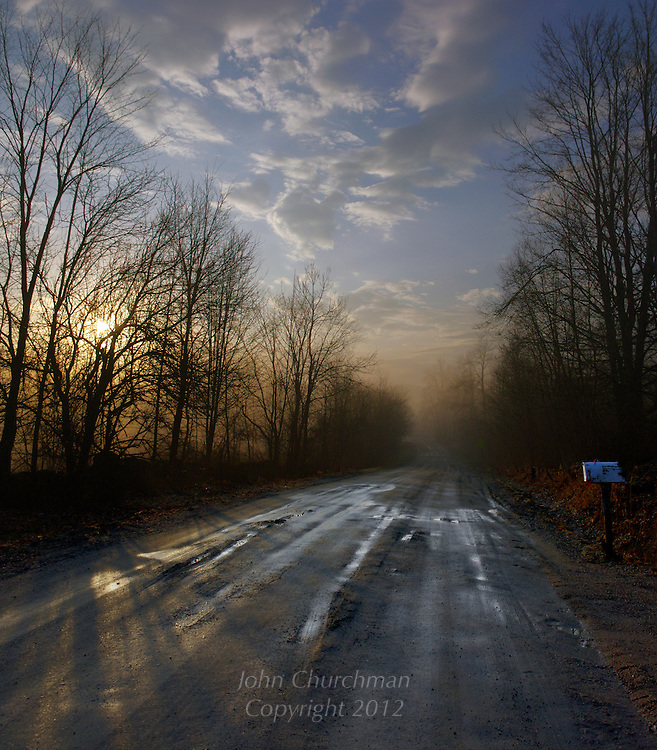 Muddy road at sunrise, Vermont