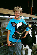 NJ, Boy and cow at Sussex County Farm and Horse Show