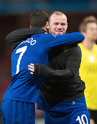 LONDON, ENGLAND - Tuesday, May 5, 2009: Manchester United's two-goal hero, the meretricious Cristiano Ronaldo, celebrates his side's 3-1 victory over Arsenal with team-mate Wayne Rooney during the UEFA Champions League Semi-Final 2nd Leg match at the Emirates Stadium. (Photo by David Rawcliffe/Propaganda)