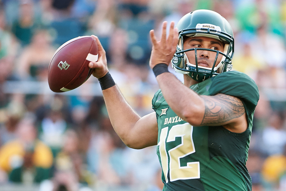 WACO, TX - SEPTEMBER 2:  Anu Solomon #12 of the Baylor Bears drops back to pass against the Liberty Flames during a football game at McLane Stadium on September 2, 2017 in Waco, Texas.  (Photo by Cooper Neill/Getty Images) *** Local Caption *** Anu Solomon