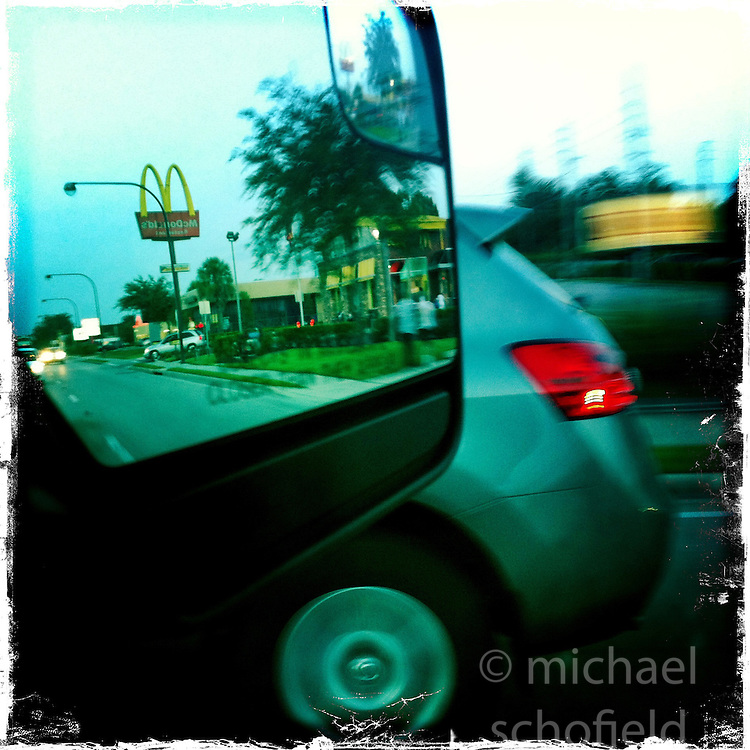 McDonalds in mirror, night drive. Orlando holiday 2012. Photo taken with the Hipstamatic photo application on Apple iPhone 4.