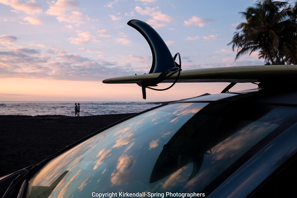 HI00363-00...HAWAI'I - Surfboard and car at Punalu'u Beach Park on the island of Hawai'i.