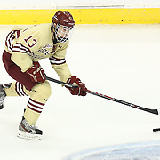 Johnny Gaudreau #13 of the Boston College Eagles skates with the puck during The Beanpot Championship Game at TD Garden on February 10, 2014 in Boston, Massachusetts. (Photo by Elan Kawesch)