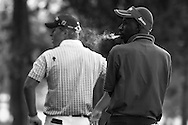 Lindani Ndwandwe has a smoke as his group waits to tee off during the opening round of the 2006 Telkom PGA Championship.