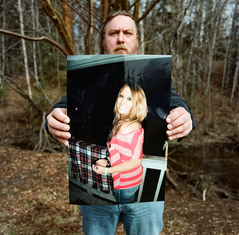 ANCHORAGE, ALASKA - MAY 2013: James Koenig holding one of the most recent photos he had of his daughter Samantha Koenig before she murdered.