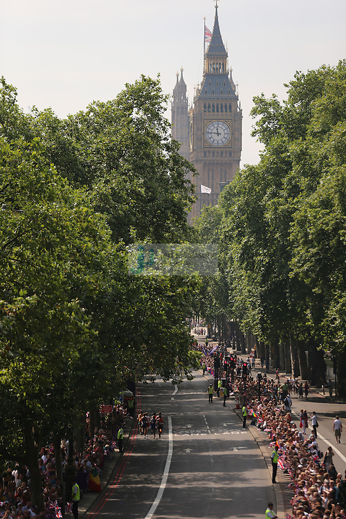 Runners run toward BIg Ben during the men's marathon during day 16 of the London Olympic Games in London, England, United Kingdom on August 12, 2012..(Jed Jacobsohn/for The New York Times)..