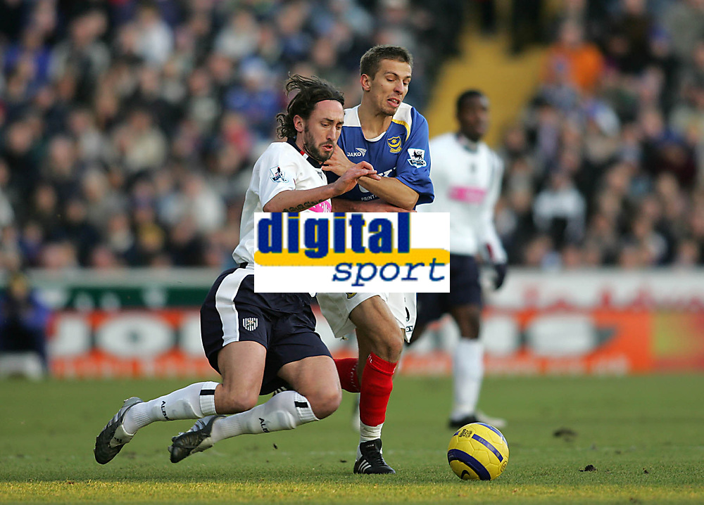 Photo: Lee Earle.<br /> Portsmouth v West Bromwich Albion. The Barclays Premiership. 17/12/2005. West Brom's Jonathon Greening (L) battles with Gary O'Neil.