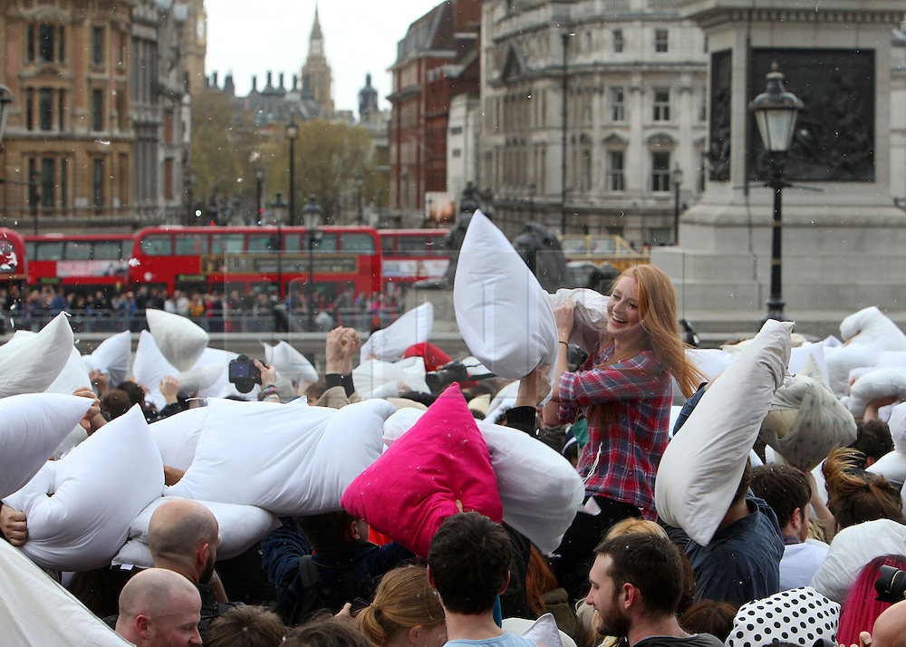 © Licenced to London News Pictures. 05/04/2014. London. UK.  <br /> Pillow fight enthusiasts are pictured getting in the spirit of things during International Pillow Fight Day in Trafalgar Square in London, April 5th 2014. Organised by the Urban Playground Movement, pillow fights take place across various cities in the world today aiming to make events in public spaces become a significant part of popular culture.<br /> Photo Credit: Susannah Ireland