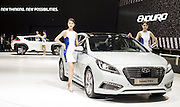 South Korean automaker Hyundai Motor's Sonata Plug-in Hybrid (front R) and Enduro are displayed during a press preview of the Seoul Motor Show in Goyang, north of Seoul, April 2, 2015. Photo by Lee Jae-Won (SOUTH KOREA) www.leejaewonpix.com/
