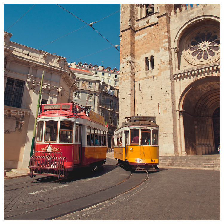 Trams crossing by Lisbon Se cathedral