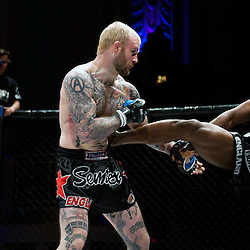 GALORE BOFANDO DRIVES A KICK IN TO THE SIDE OF PETER IRVING - UCMMA 34 2 JUNE 2013