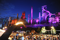 """8/4/2011 Bethlehem, PA Fans of Musikfest had a sneak peek Thursday evening. Musikfest held a preview night at the SteelStacks complex offering free music and family friendly entertainment. The night also included the lighting of the """"Bridge"""" a natural gas lit arch sculpture symbolizing the significance of Bethlehem's contribution to industrial history."""
