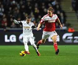 Swansea City's Pablo Hernandez shields the ball from Fulham's Dan Burn - Photo mandatory by-line: Alex James/JMP - Tel: Mobile: 07966 386802 28/01/2014 - SPORT - FOOTBALL - Liberty Stadium - Swansea - Swansea City v Fulham - Barclays Premier League