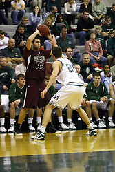 16 December 2006: Andrew Gilmore gets in the face of Jason Vismantas. The University of Chicago Maroons upset  the Illinois Wesleyan Titans 64 - 60 at the Shirk Center in Bloomington Illinois.<br />