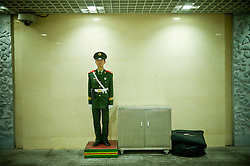 A Chinese military policeman stands guard inside the subway next to the entrance of the Forbidden City during the closing ceremony of the Beijing 2008 Olympic Games  August 24, 2008. (Photo By Ami Vitale)