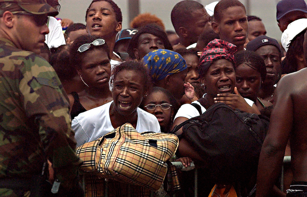 Victims of Hurricane Katrina argue with National Guard Troops as they try to get on buses headed to Houston, TX on Thursday morning.  Willie J. Allen Jr.