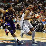 Alyssa Thomas, (right), Connecticut Sun, drives to the basket past Alana Beard. Los Angeles Sparks, during the Connecticut Sun Vs Los Angeles Sparks WNBA regular season game at Mohegan Sun Arena, Uncasville, Connecticut, USA. 3rd July 2014. Photo Tim Clayton
