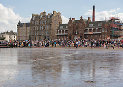 Later in the day alongside the Portobello Big Beach Busk there was a Beach Rocket competition on the sands organised by Portobello Community Council. All shapes and sizes of home made plastic bottle rockets, powered only by water and an air pump, arced over the sand, watched by a large crowd. <br /> <br /> <br /> &copy; Jon Davey/ EEm