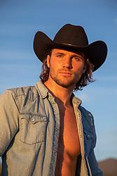 good looking cowboy at sunset