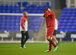 READING, ENGLAND - Wednesday, March 12, 2014: Liverpool's Daniel Trickett-Smith looks dejected after losing 5-4 on penalties after a 4-4 draw against Reading during the FA Youth Cup Quarter-Final match at the Madejski Stadium. (Pic by David Rawcliffe/Propaganda)