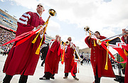 Matt Konz, left, looks on as the Herald Trumpets warm up prior to the University of Wisconsin-Madison commencement ceremony at Camp Randall Stadium, Saturday, May 17, 2014.