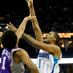 December 30, 2011; New Orleans, LA, USA; New Orleans Hornets small forward Trevor Ariza (1) shoots over Phoenix Suns shooting guard Josh Childress (1) during the second quarter of a game at the New Orleans Arena.   Mandatory Credit: Derick E. Hingle-US PRESSWIRE