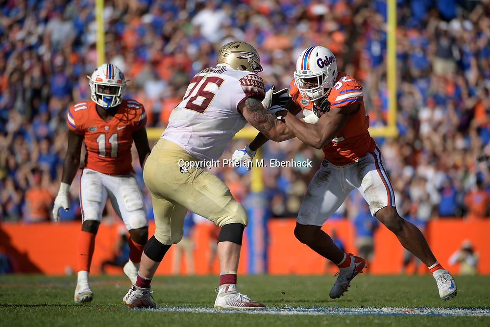 Florida defensive lineman Jabari Zuniga (92) works against Florida State offensive lineman Rick Leonard (76) during the second half of an NCAA college football game Saturday, Nov. 25, 2017, in Gainesville, Fla. FSU won 38-22. (Photo by Phelan M. Ebenhack)