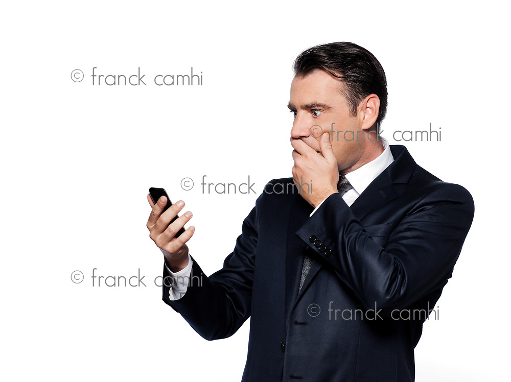 handsome caucasian man looking at phone amazed portrait isolated studio on white background