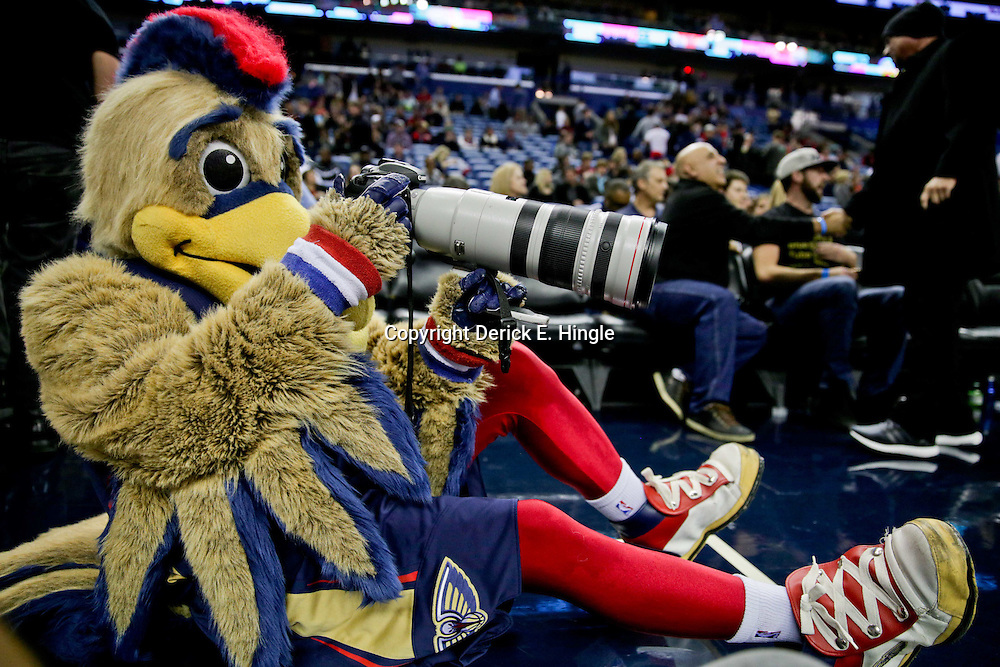 Jan 6, 2016; New Orleans, LA, USA; New Orleans Pelicans mascot Pierre the Pelican holds a camera courtside during the second half of a game against the Dallas Mavericks at the Smoothie King Center. The Mavericks defeated the Pelicans 100-91. Mandatory Credit: Derick E. Hingle-USA TODAY Sports