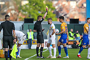 Dan Butler (3) receives a yellow card during the EFL Sky Bet League 2 second leg Play Off match between Mansfield Town and Newport County at the One Call Stadium, Mansfield, England on 12 May 2019.
