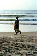 Woman walking on Dakar Beach