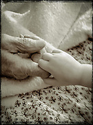 My sister took this picture of our father's hand being held by his great granddaughter, Lennon.