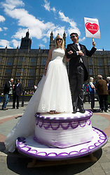 House of Lords.<br /> Protestors outside the House of Lords ahead of the Lords debating the Gay Marriage Bill. Pic Shows Martin Etchart and Kerrie Hardy dressed as wedding cake figures outside Parliament, London, UK,<br /> Monday 3rd, June 2013<br /> Picture by i-Images