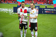 Jesse Lingard of Manchester United and Juan Mata of Manchester United the goalscorers with the FA Cup during the The FA Cup Final between Crystal Palace and Manchester United at Wembley Stadium, London, England on 21 May 2016. Photo by Phil Duncan.
