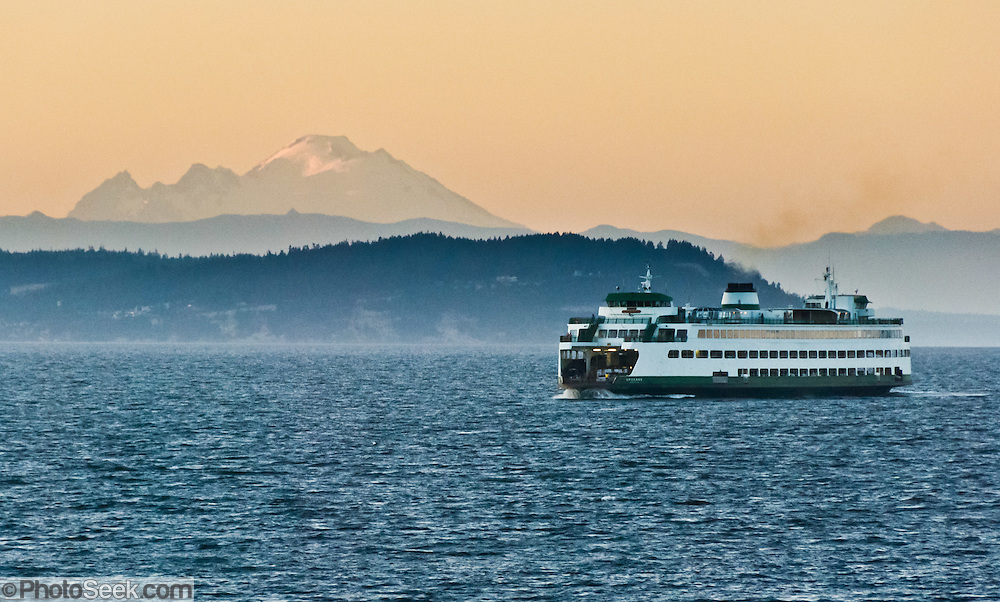 The Spokane, part of the Washington State Ferry system, cruises in Puget Sound from Edmonds to Kingston in sight of Mount Baker (10,775 feet elevation), Washington.
