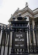 Bank of Ireland way out sign, College Green branch, Dublin 2. The bank received a 3.5 billion euro Irish government bailout following the 2008 financial crisis.